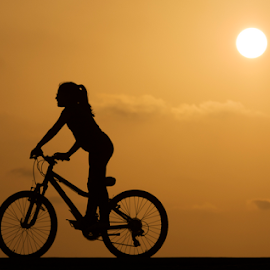 Riding at sunset by Yuval Shlomo - Sports & Fitness Cycling