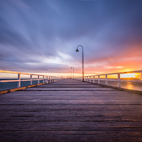 Just a common Pier with uncommon colours by Zubair Aslam - Buildings & Architecture Bridges & Suspended Structures ( clouds, calm, water, dynamic sky, sky, melbourne, sunset, pier, long exposure, still water, golden hour, colours, sunrise,  )