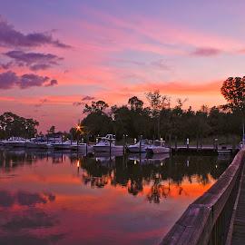 Inner Harbor Sunset by Jim Howton - Landscapes Sunsets & Sunrises ( harbor, sunset, boats, pier, ocean springs )