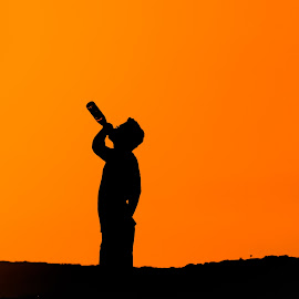I Drink the Sun's thirst by San Jay - People Street & Candids ( silhoutte of a man, sunset, beer bottle, silhoutte, man )