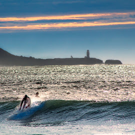 Oregon Coast Surfing by Andy Vic Lindblom - Sports & Fitness Surfing ( clouds, sky, surfing, blue, waves, light house, pacific, ocean, coast )