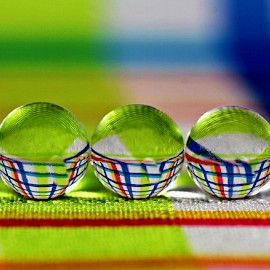 by Dipali S - Artistic Objects Glass ( abstract, balls, color, artistic, spheres, stripes, fabric, refraction )