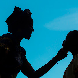 Motherly Love by Jason Confer - People Family ( mother, african, family, silhouette, silhouettes,  )
