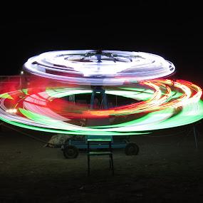 Round Round by Rahul Savaliya - City,  Street & Park  Night ( new, color, joy, dragon, children, fun, smile, light, boy )