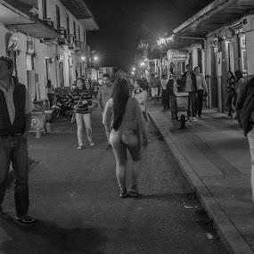 Hipocresia by Jose German - City,  Street & Park  Night ( lightning, b&w, girl, street, fireworks, night, people, crowd, humanity, society,  )