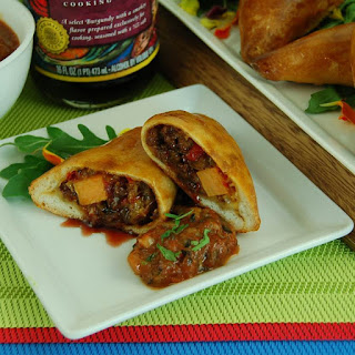 Stuffed Empanadas with Braised Burgundy Beef Picadillo and Queso Chihuahua