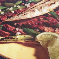 Beef Adobado Tacos with Grilled Green Onions