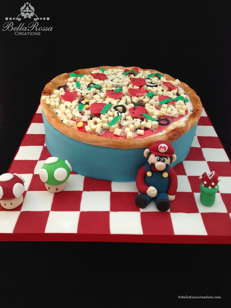 3D Mario Bros pizza cake, consisting of vanilla sponge cake with caramel ganache and decorated with edible pizza toppings made from chocolate and gum paste. Ideal for the pizza loving kids birthday party.