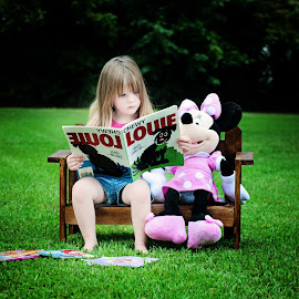 Just doing some reading by Ashley Blake - Babies & Children Toddlers ( girl, grass, minniemouse, book, outside )