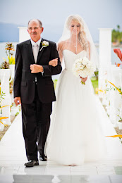 A bride walking down the aisle with her father