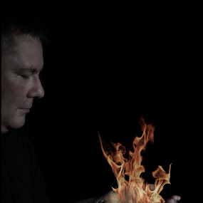 Holding Flames  by Lisa Kirkwood - Digital Art People ( man holding flames )