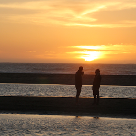 Pacific Sunset by Mike Logan - People Couples ( sunset, beach, couples on the beach )