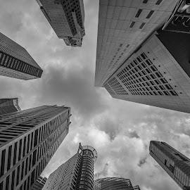 Looking up.. by Wim Swyzen - City,  Street & Park  Skylines ( clouds, skyline, sky, b&w, financial center, singapore )
