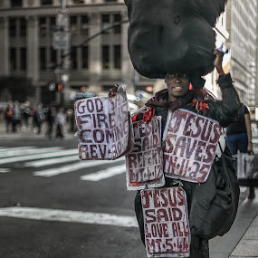 Bringing the word God. by Gimo Nasiff - People Street & Candids ( signs, god, nyc, messages, city, new, financial district, woman, jesus, lady, york, smile, black, downtown,  )