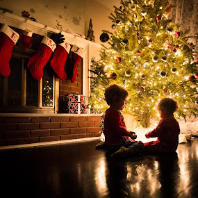 Christmas Eve by Mike DeMicco - Public Holidays Christmas ( xmas, christmas, children, kids, siblings, glow, cute, child, love, playing, stockings, sweet, tree, happy, new years eve, fireplace, light, new years )