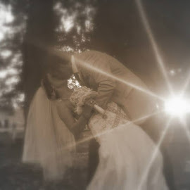 Sunset Wedding Kiss by Sandy Darnstaedt - People Couples