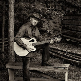 Dan Profitt  by George Holt - People Portraits of Men ( b/w, cowboy boots, cowboy hat, cowboy, dan profitt, black and white, black & white, guitarist, guitar, musician,  )