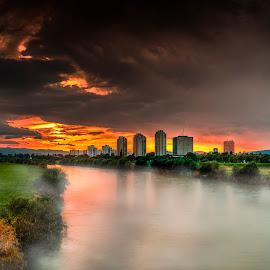 Sunset on the river Sava by Hrvoje Kunović - Landscapes Sunsets & Sunrises ( sava, fog, skyscrapers, sunset, zagreb, river )