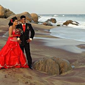 Sinhalese Wedding by Tamsin Carlisle - Wedding Bride & Groom ( sand, waves, sea, rock, beach, sri lanka, landscape, red, dress, wedding, kirinda, bride and groom, bride, groom )