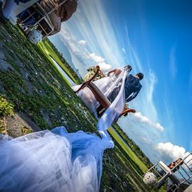 Garden Wedding by Joey Rico - Wedding Ceremony ( blue sky, wedding, veil, ceremony, bride, groom, garden )