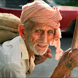 Burden Of Poverty  by Nayyer Reza - People Street & Candids ( pakistan, color, burden, old man, man with sack, nayyer, burden of poverty, reza )