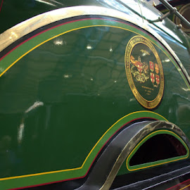 Green and Curvy by Chrissie Barrow - Transportation Trains ( curve, reflection, arch, metal, green, train, shiny,  )