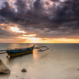 The boat and the light by Jee Cornelius - Landscapes Cloud Formations ( clouds, sky, afternoon, sunset, rock, beach, boat,  )