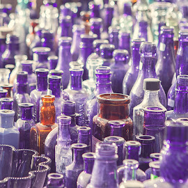 Sea of Light and Glass by Angel McNall - Artistic Objects Antiques ( antique glass, purple bottles, purple, still life, flea market, vintage glass, bottles, swap meet, bokeh, antiques )