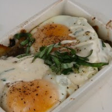 Baked Eggs with Mushrooms, Leeks, Parmesan, and Bechamel