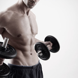 A man holding two dumbbells by Николай Кръстев - Sports & Fitness Fitness ( fitness, gym, health, dumbbells, man )