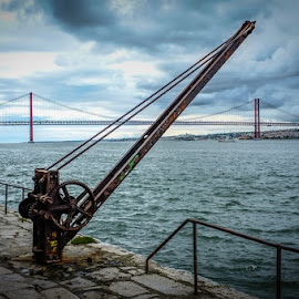 Old Crane 2 by Paulo Silva - Landscapes Waterscapes ( water, resty, old, cacilhas, tejo river, sea, old crane, portugal, decay )