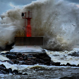 Stormy weather by Didzis Sedlenieks - Buildings & Architecture Other Exteriors ( piers, waves, sea, beacon, storm )