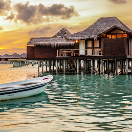 Sunset in Maldives by Mo Harrim - Landscapes Travel ( clouds, water, reflection, warm, sea, ocean, travel, landscape, boat, anantara, sun, island, lights, veli, over, sky, village, villa, sunset, hotel, maldives )