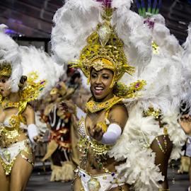 Samba Dancers at Carnaval  by Samy St Clair - People Street & Candids ( excitement, dancing, latin american and hispanic ethnicity, cultural, sex symbol, sensuality, jewelry, beauty, bikini, party, school of samba parade, feather, multi colored, cultural heritage, parade, traditional culture, sexy, samba (brazilian), female body, movement, action, gold, motion, smile, cheerful, smiling, dancer, sao paulo, samba dancing, music festival, singing, carnival, beautiful, white, happiness, fun, women, sambadrome, brazil, female, headdress, costume, samba school, celebration, dance, culture, traditional festival, competition )
