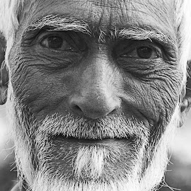 Wrinkled by Amit Aggarwal - People Portraits of Men ( white beard, suraj kund, crafts mela, 2014, black & white, faridabad, indian, old man, portrait, aged )