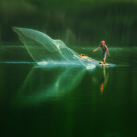 catching fish by Hari Wiwoho - People Portraits of Men (  )