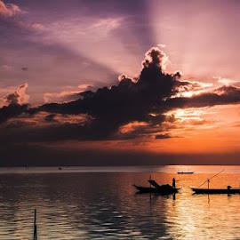 Ketika kau bersembunyi di balik awan Ada keindahan terpancar disana! .....  (view @northern beach of sby) by Andik Hariyanto - Landscapes Sunsets & Sunrises