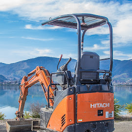 Little digger by Vibeke Friis - Transportation Other ( water, hills, orange digger, blue, orange. color )
