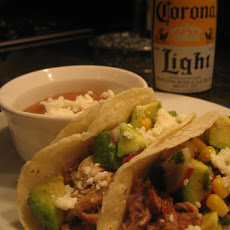 Slow Cooked Pork Carnita Tacos with Corn and Avocado Salsa