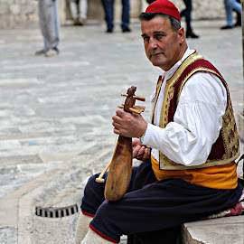 Croatia by Glyn Thomas Jones - People Musicians & Entertainers ( music, musical instrument, croatia, traditional, musician )