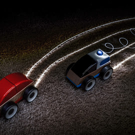 Toy Car Chase by Justin Murazzo - Abstract Light Painting ( car, wood, swirl, line, carpet, chase, long, toy, police, drive, trail, experiment, dark, slow, painting, light, burnout, black, speed, experimental, pursuit, siren, streak, red, blue, shutter, brown, night, delay )