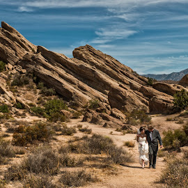 A loving heart is the beginning of all knowledge. by Yansen Setiawan - Wedding Bride & Groom ( love, blue sky, nature, wedding, rocks )