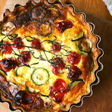 Roasted Tomato, Courgette, Pea And Spring Onion Quiche