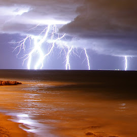Lightning strikes by Craig Eccles - News & Events Weather & Storms ( clouds, thunder, lightning strike, lightning, lightning bolt, event, weather, thunder storm, ocean, beach, thunder bolt, news. )