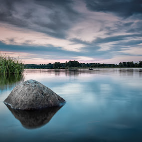Sunset over calm water and rock. by Per-Ola Kämpe - Landscapes Waterscapes ( clouds, water, reflection, reed, sky, waterscape, sunset, lake, rock,  )