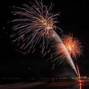 Fireworks Over The Beach by Daniel Gorman - Abstract Fire & Fireworks ( water, sand, orange, purple, maine, green, ocean, beach, fire, old orchard beach, beaches, red, old orchard, color, fireworks, light, , the mood factory, mood, lighting, sassy, pink, colored, colorful, scenic, artificial, lights, scents, senses, hot pink, confident, fun, mood factory , mood factory, vibrant, happiness, January, moods, emotions, inspiration )