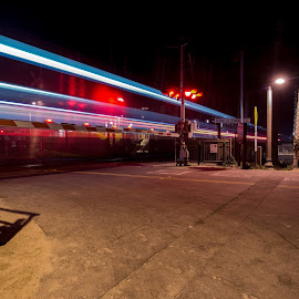 Train Crossing by Tim Mikolajczyk - City,  Street & Park  Street Scenes ( san clemente, railroad, night, long exposure, beach, trains )