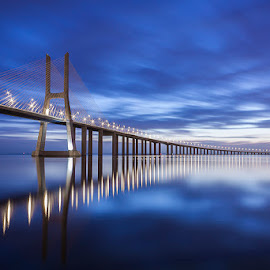 in blue by Emanuel Ribeiro - Buildings & Architecture Bridges & Suspended Structures ( amazing, clouds, dawn, blue, bridge, river )