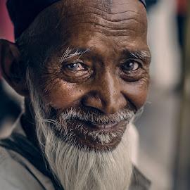 That White Beard Familiar Man by Rishav Chakraborty - People Portraits of Men ( muslim, textured skin, pixonova, rishav chakraborty photography, white beard, beggar, white and pink background, kolkata, white, sweet smile, smile, detailed skin )