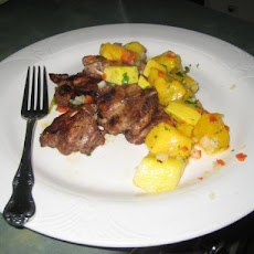 Jerk Chicken Thighs With Mango Salsa